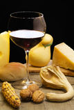 Red wine with cheese and autumnal decoration Royalty Free Stock Photography