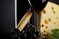 Red wine and cheese on black Royalty Free Stock Image