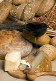 Red Wine with Cheese and Bread 3. A glass of Red wine with an assortment of breads and cheeses Stock Photos