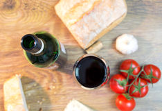 Red wine, cheese, bread Stock Images