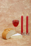 Red wine, cheese, bread and candles Stock Photos