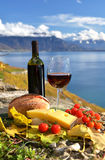 Red wine, cheese, bread and cherry tomatoes Stock Photo