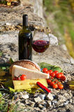 Red wine, cheese, bread and cherry tomatoes Royalty Free Stock Photo