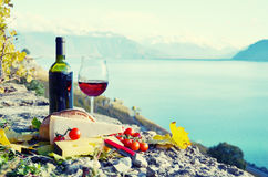 Red wine, cheese, bread and cherry tomatoes. Royalty Free Stock Photos