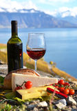 Red wine, cheese, bread and cherry tomatoes Stock Image