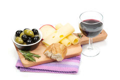 Red wine with cheese, bread, olives and spices Stock Photography
