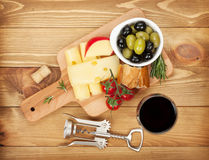 Red wine with cheese, bread, olives Royalty Free Stock Images