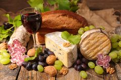 Red wine, cheese and bread. On wood Royalty Free Stock Image