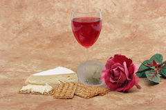 Red wine, cheese, crackers and rose Stock Photos