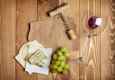 Red wine, cheese and grape Stock Photos
