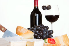 Red wine, cheese and grapes. With a white background Stock Image
