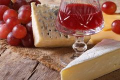 Red wine with cheese and grapes close-up horizontal Stock Photo