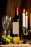 Red wine with cheese and grapes plate Stock Images