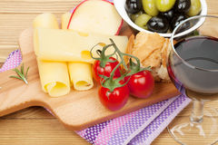 Red wine with cheese, olives, bread, vegetables Royalty Free Stock Photo