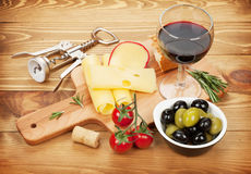 Red wine with cheese, olives, bread, vegetables and spices Royalty Free Stock Photography