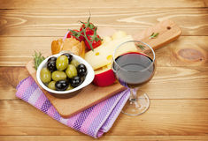 Red wine with cheese, olives, bread, vegetables and spices Royalty Free Stock Photos
