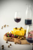 Red wine and cheese platter on white background royalty free stock photos