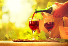 Red wine and cheese. Pouring wine closeup Royalty Free Stock Photo