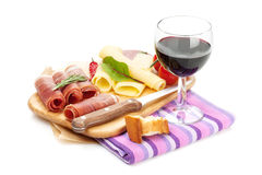 Red wine with cheese, prosciutto, bread, vegetables and spices Royalty Free Stock Photos