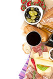 Red wine with cheese, prosciutto, bread, vegetables and spices Stock Photos
