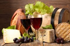 Red wine, cheese. And bread Stock Images