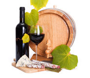 Red wine with cheese snack and little barrel Stock Photography