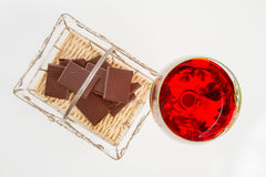 Red wine and chocolate bar. Selective focus Royalty Free Stock Image