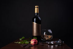 Red wine and chocolate. A bottle of wine and chocolate on the table Royalty Free Stock Images