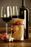 Red wine, christmas bauble and gingerbread Stock Image