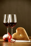 Red wine, christmas bauble and gingerbread Royalty Free Stock Photo