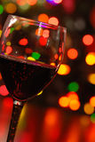 Red wine with christmas lights Royalty Free Stock Photos