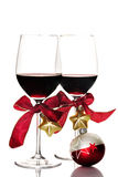 Red wine and Christmas ornaments Stock Photo