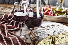 Red Wine, ciabatta, olives, appetizer, drink, food, wooden, delicious, dinner, snacks for wine, close-up royalty free stock photo