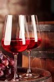 Red wine.Clsoseup of two glasses of red wine, grapes and barrel.Selective focus.Copy space stock photo