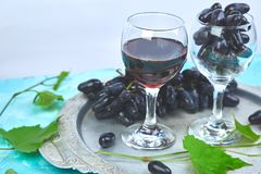 Red wine concept with bottle, glass and grapes royalty free stock photography