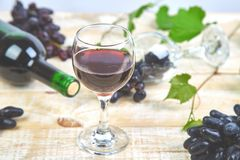 Red wine concept with bottle, glass and grapes stock photo