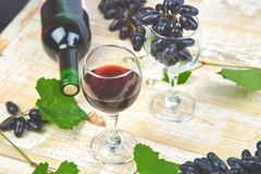 Red wine concept with bottle, glass and grapes stock images