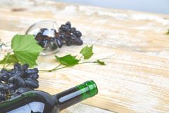 Red wine concept with bottle, glass and grapes royalty free stock image