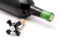 Red wine cork and bottle. Red wine tap cork and bottle isolated on white Stock Image