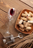 Red wine, corks and corkscrew Royalty Free Stock Image