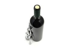 Red wine and corkscrew Royalty Free Stock Photo