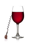 Red wine and corkscrew Royalty Free Stock Images
