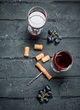Red wine with corkscrew stock photo