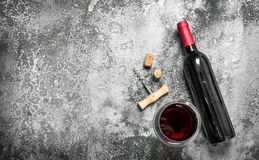 Red wine with a corkscrew. Stock Photos