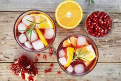 Red wine cranberry citrus pomegranate sangria. Top view, rustic wooden background. Red wine cranberry citrus pomegranate sangria. Top view, space for text royalty free stock photo