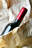 Red wine and crumpled paper-bag Royalty Free Stock Photography