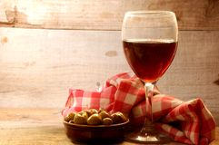 Red wine cup and olive fruit on background Royalty Free Stock Images