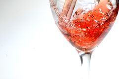Red wine cup served splash in cup Royalty Free Stock Images
