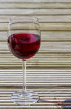Red wine on decking Stock Photos