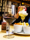 Red wine an dessert. Red wine and desert at a sidewalk cafe Stock Image